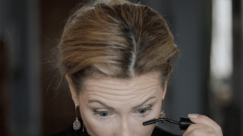 When putting mascara on your lower lashes, tilt your chin down to lift lashes away from the face.